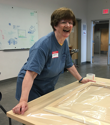 Susan putting together a window insert